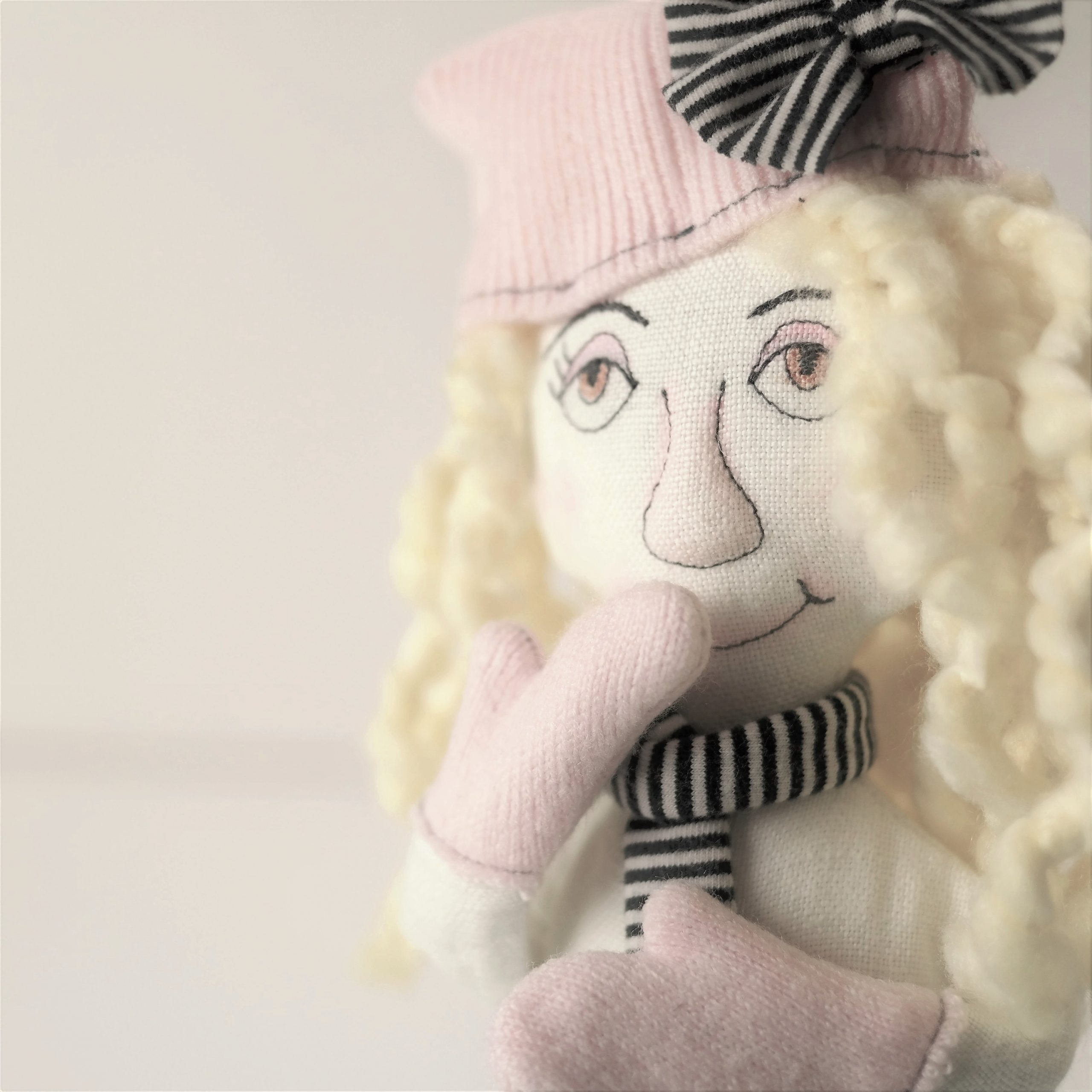 white linen doll with yellow hair