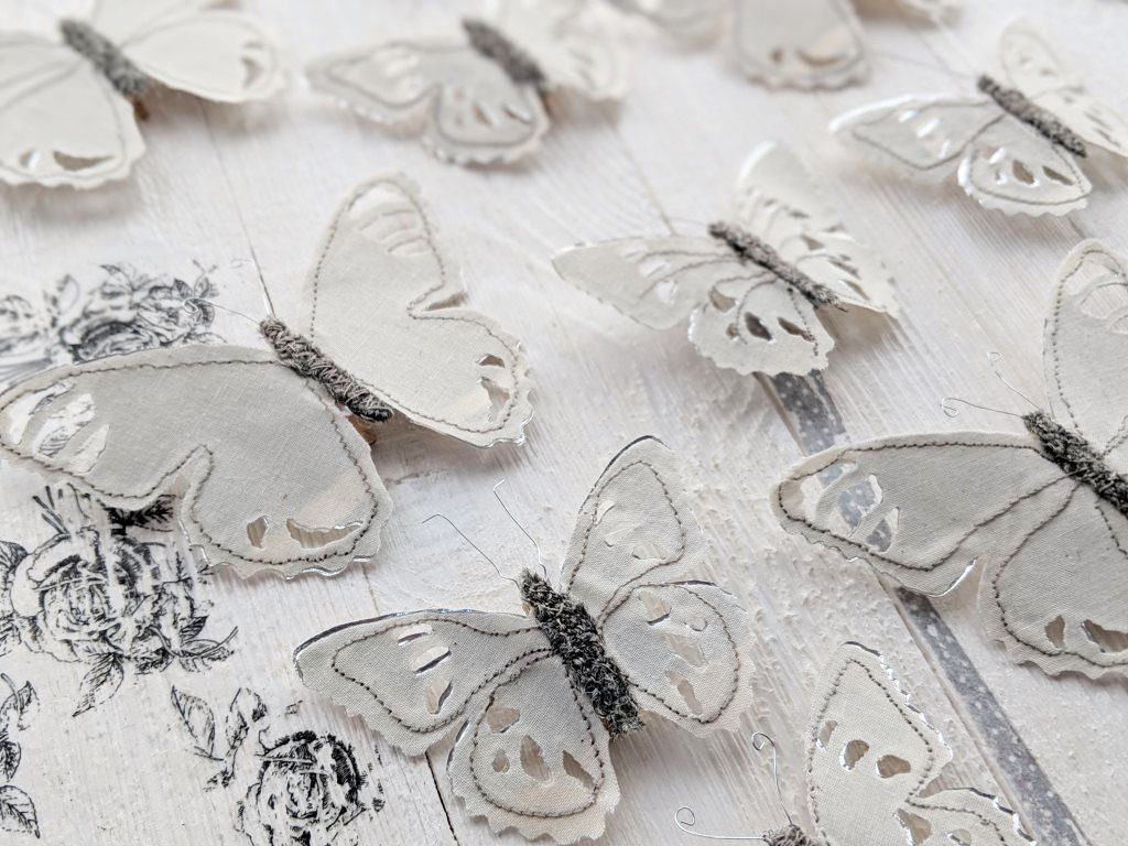 closeup of stitched butterflies