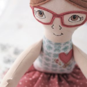 cloth doll with glasses made with sizzix kid giddy die