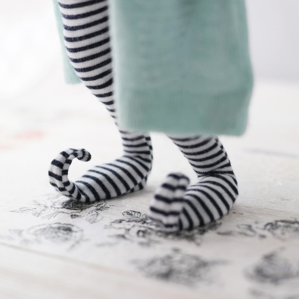 elf cloth doll curly toe closeup