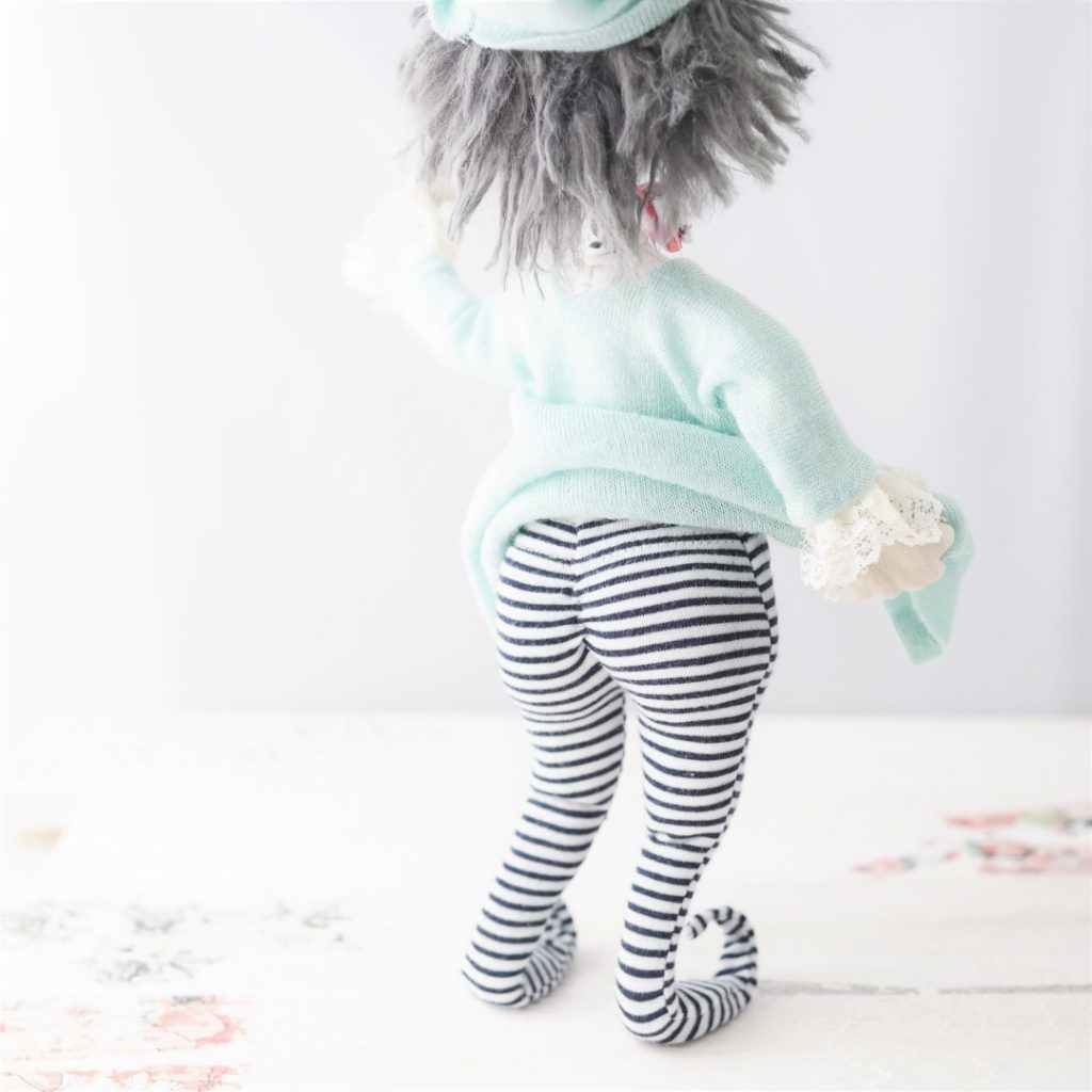 elf doll stripy tights behind