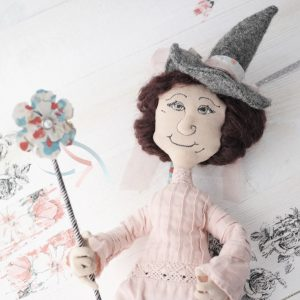 pink witch cloth doll with embroidered face