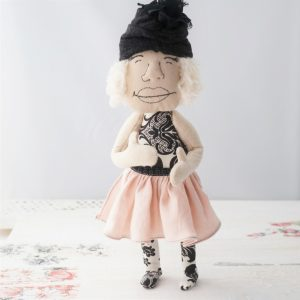 happy doll in pink and black