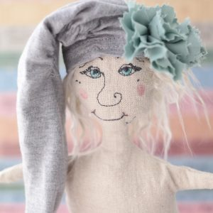 linen doll face closeup