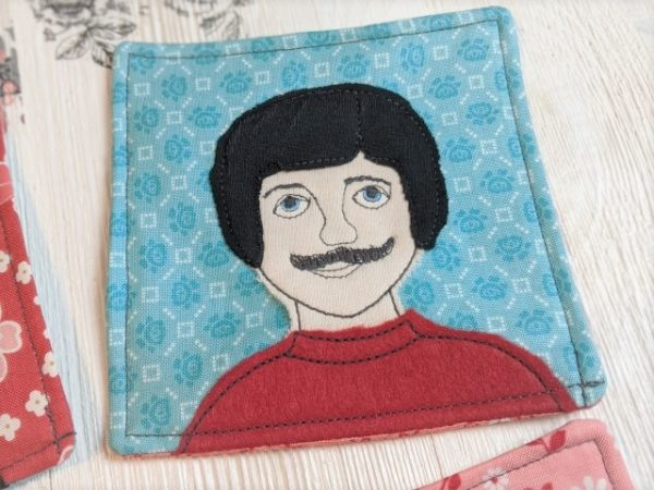 coaster with mustache guy