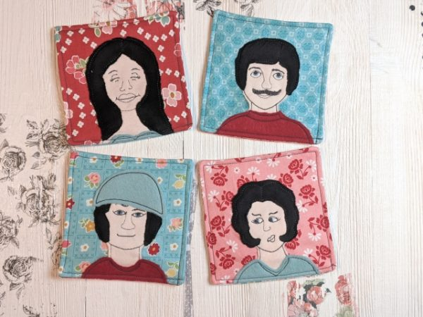 4 coasters with character applique