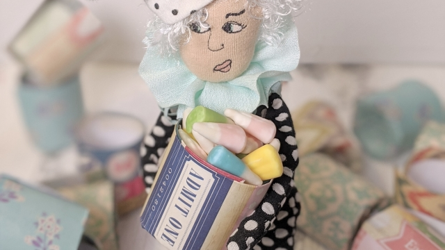 ballyhoo doll holding candy in a paper pot